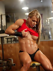 Bodybuilder Larissa Reis is in the gym, posing, and she looks so good from every angle it's hard to choose. Like those big biceps? Those shredded, vascular abs? Her sexy pecs? Her massive legs? How about that tough tattoo? She's one buff blonde.