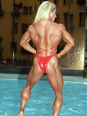 Christine Moore showing off impressive muscle size in her red bikini