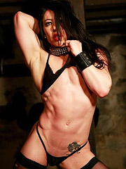 Sexy female bodybuilder and porn star Carmin Blue has gotten herself into a bind again. She finds herself restrained in a dungeon - and apparently, this has happened to her before because she stays calm, cool, and collected. She also shows off her amazing body as she poses and flexes her hard muscle and plays wth her swollen pussy.