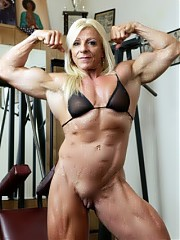 Lacey flexes her big, muscular clit