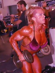 The women bodybuilders pumping up and posing