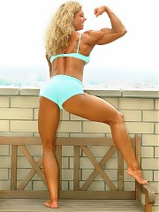 Rebekka Armstrong shows off good overall development but with a very impressive and detailed upper body, particularly her arms