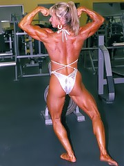 The very young looking 46 year old Holly Nicholson showing off evenly developed muscularity in a white bikini