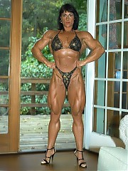 Nursel Gurler poses in a black bikini, all the muscle shots are show, with emphasis on her unreal upper body