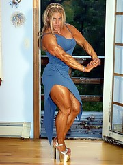 Marja Lehtonen showing off her trademark unreal biceps as well as her incredible development overall
