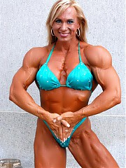 Sherry Smith's physique is complete with a heavily muscled upper body featuring large, round biceps, immense triceps and very Impressive chest and back. Her thighs are hugely muscled, with very, very good definition, and her pretty blonde, blue-eyed looks really enhance her overall physique package. With few exceptions, most women at Sherry's competitive level have upper bodies more developed than the legs. Not Sherry though, as you will soon see, as Sherry displays unreal thigh and calve develo...