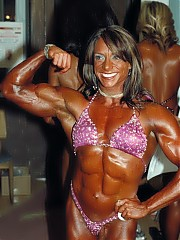 Great shots backstage of the women bodybuilders pumping up and flexing