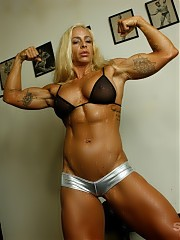 Professional female bodybuilder Jill Jaxen is in the gym, posing to show off how vascular and ripped she is, and you can look at every muscled inch of her pecs, legs, glutes, tattooed biceps and abs.