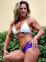 The 47 year old Kelly Dobbins shows off impressive size and definition