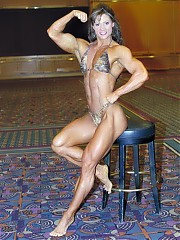 Jody May is a bodybuilder with well distributed muscle